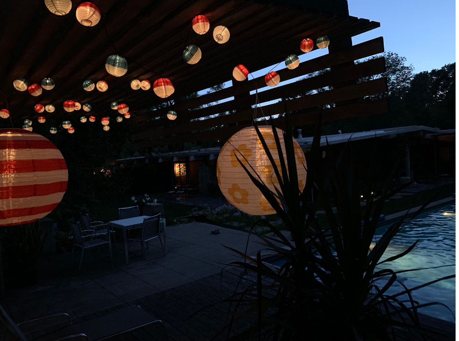 Outdoor pool with lanterns lit