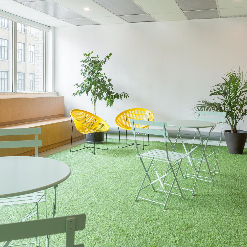 Make Lemonade coworking space photo of Indoor Patio with green astroturk and patio chairs