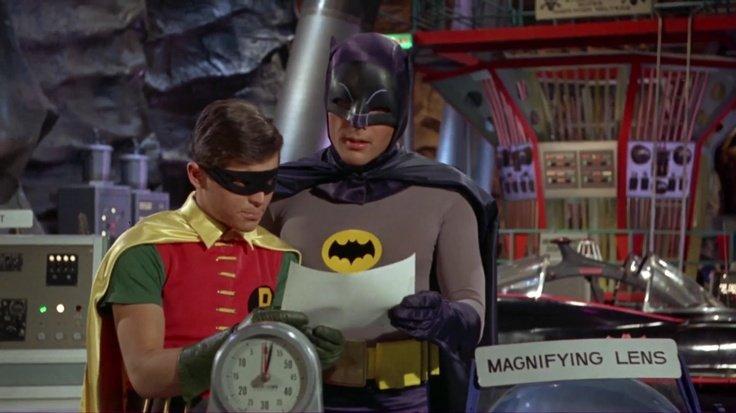 Batman and Robin examine a telegram to the batcave