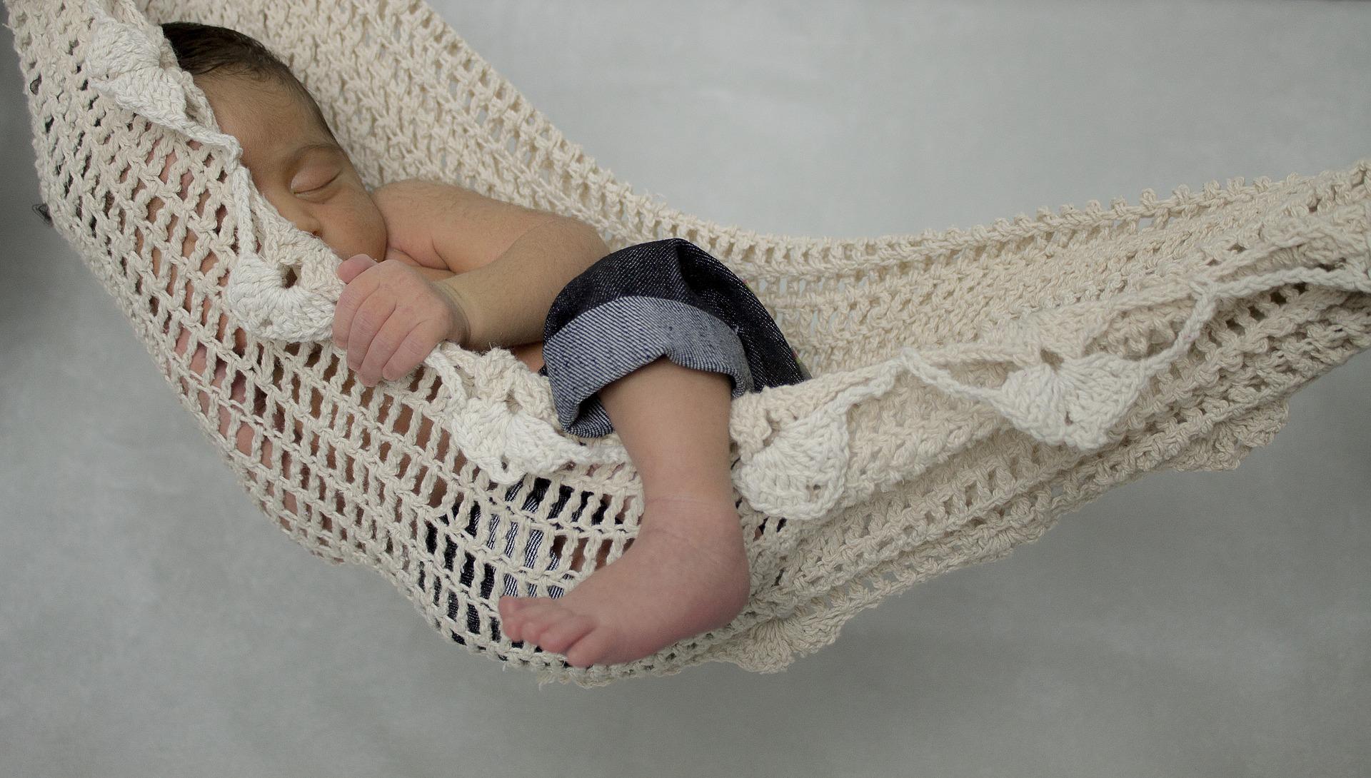 baby asleep in a hammock