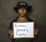 woman holding economic justice and equity photo