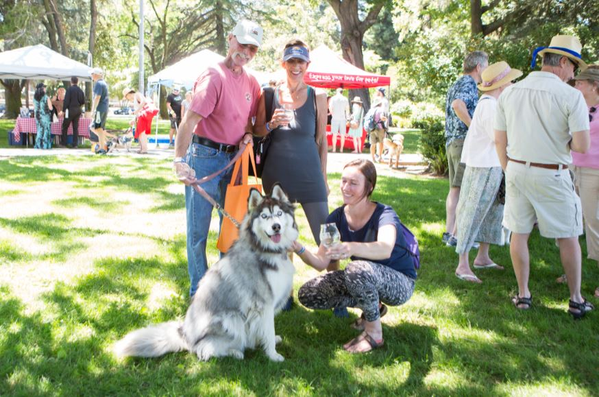 A happy husky and family enjoy Bark n' Brewfest!