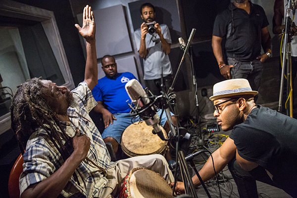 Etienne records with 'Slim' and the Moruga Bois drummers.