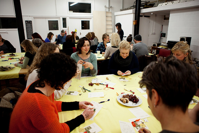 Craftivism workshop with people stitching, chatting & reflecting