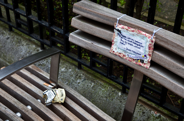 Mini Protest Banner on homelessness hung on a park bench