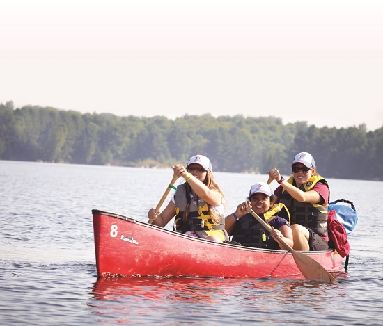 THCF campers paddle a canoe