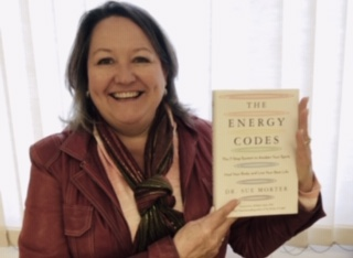 Facilitator Pauline Friessen holds the book she will introduce The Energy Codes  by Dr. Sue Morter