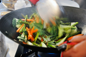 Stir fry veggies in cast iron wok