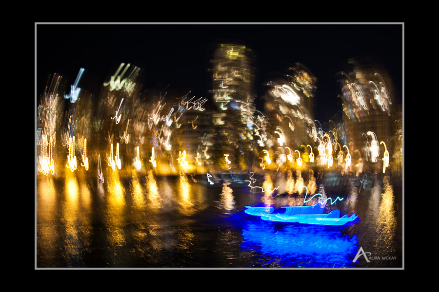 Night photography reverse light paint of Vancouver skyline with boat by Aura McKay