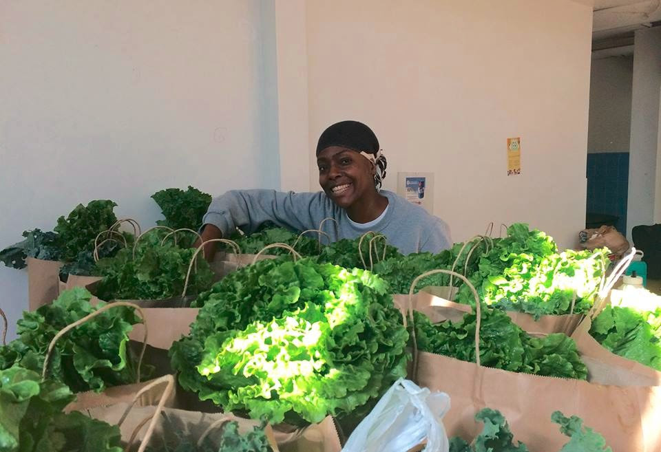 Tysha volunteering with the community controlled food initiative