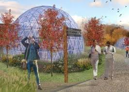 a glass dome in a community garden