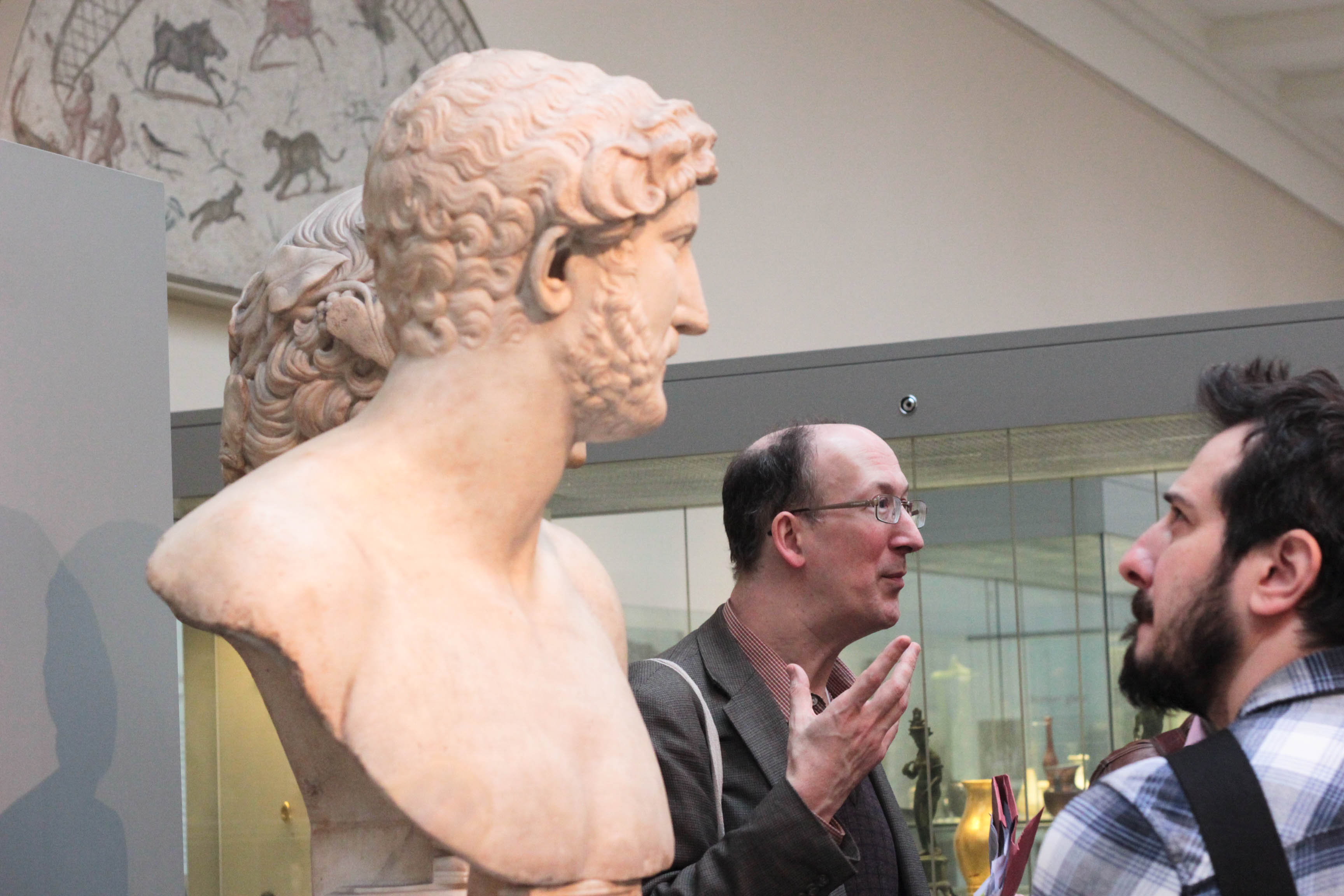 Image shows one of our Graduate courses being taught close by in the Galleries of the British Museum