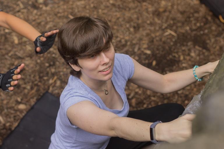 female boulderer first outdoor climb
