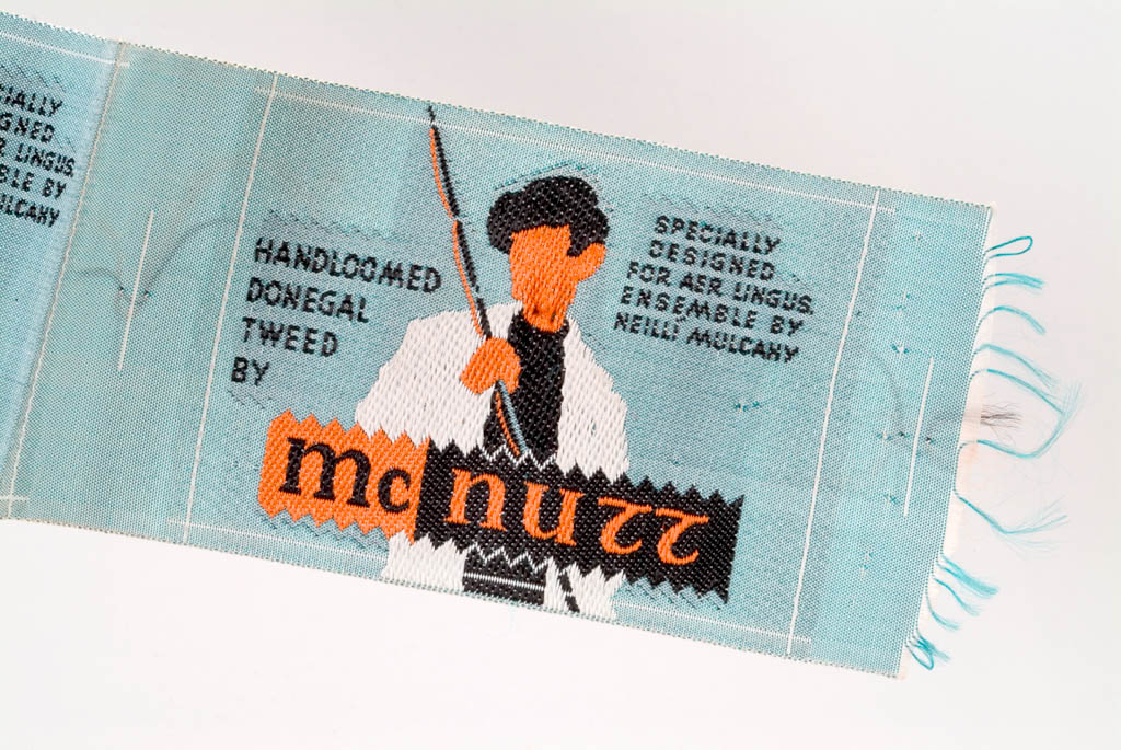 One of a strip of tweed labels for the hand loomed Donegal Tweed woven specially  by McNutt's for the Aer Lingus air hostess uniform designed by Neillí Mulcahy in 1962. Neillí Mulcahy Collection, DT:2007.58