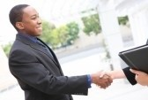 black teen shaking hands