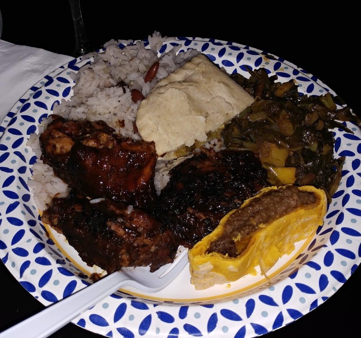 Homemade Jerk chicken, rice and peas, steamed mixed greens, beef patty and veggie patty