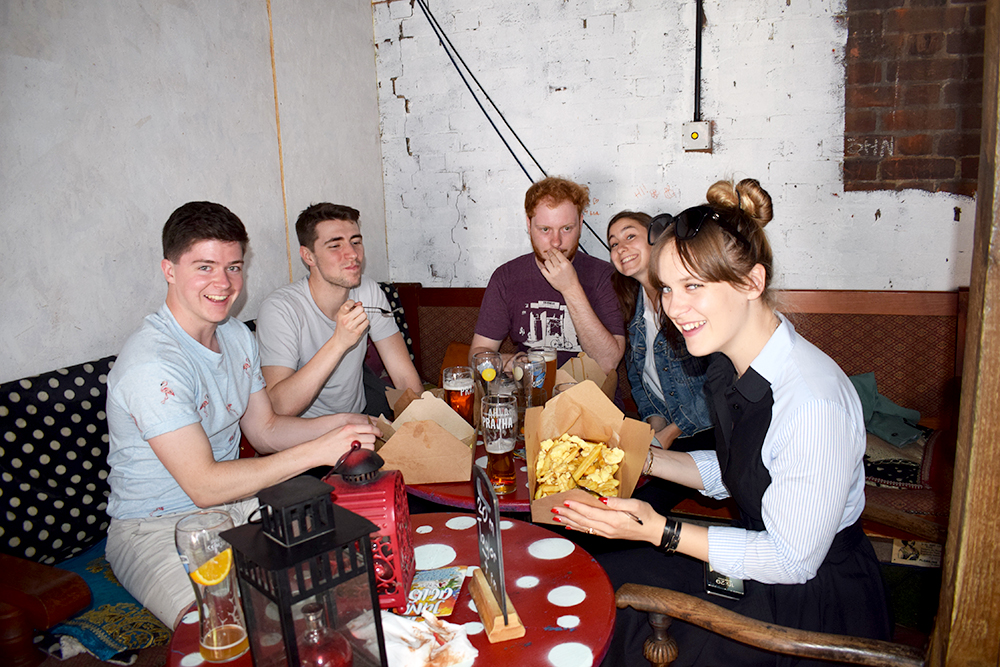 Picture of people eating some poutine