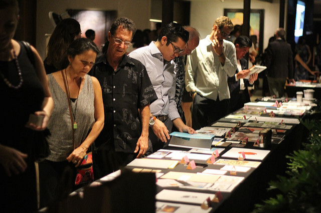 5-O show attendees browse the display of winners in 2015
