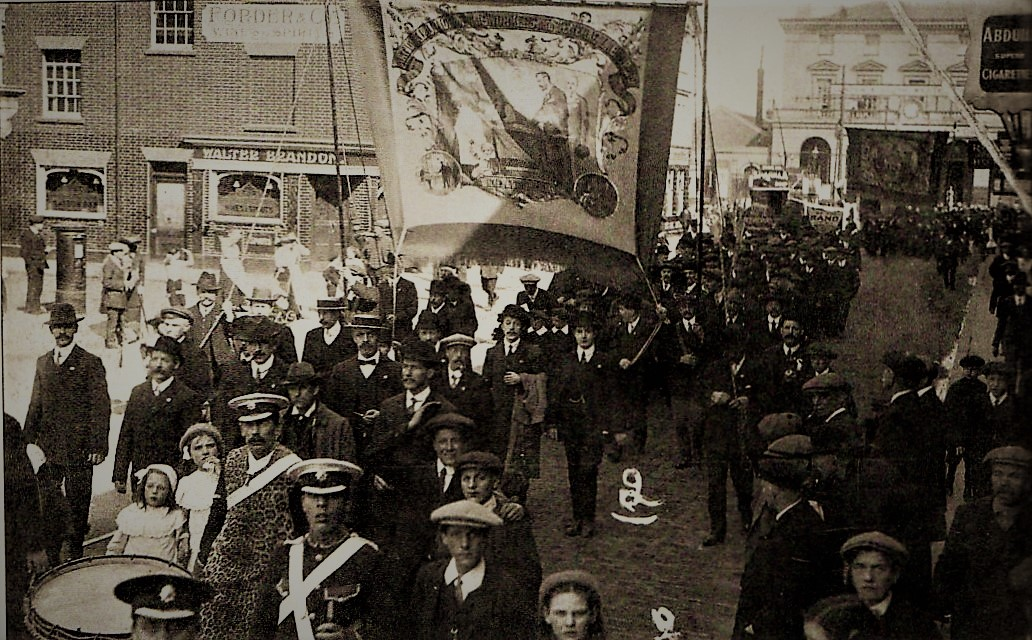 Bakers, plumbers, shipping and dock workers taking part in a demonstration, marching from the Terminus Station, Southampton, 1911.