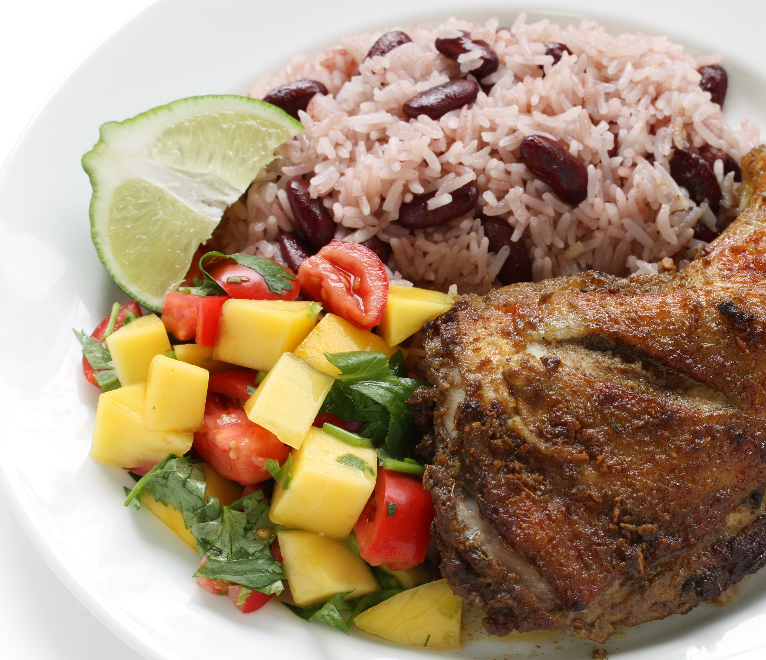 Jamaican Jerk Chikken served with our Coconut Rice & Peas