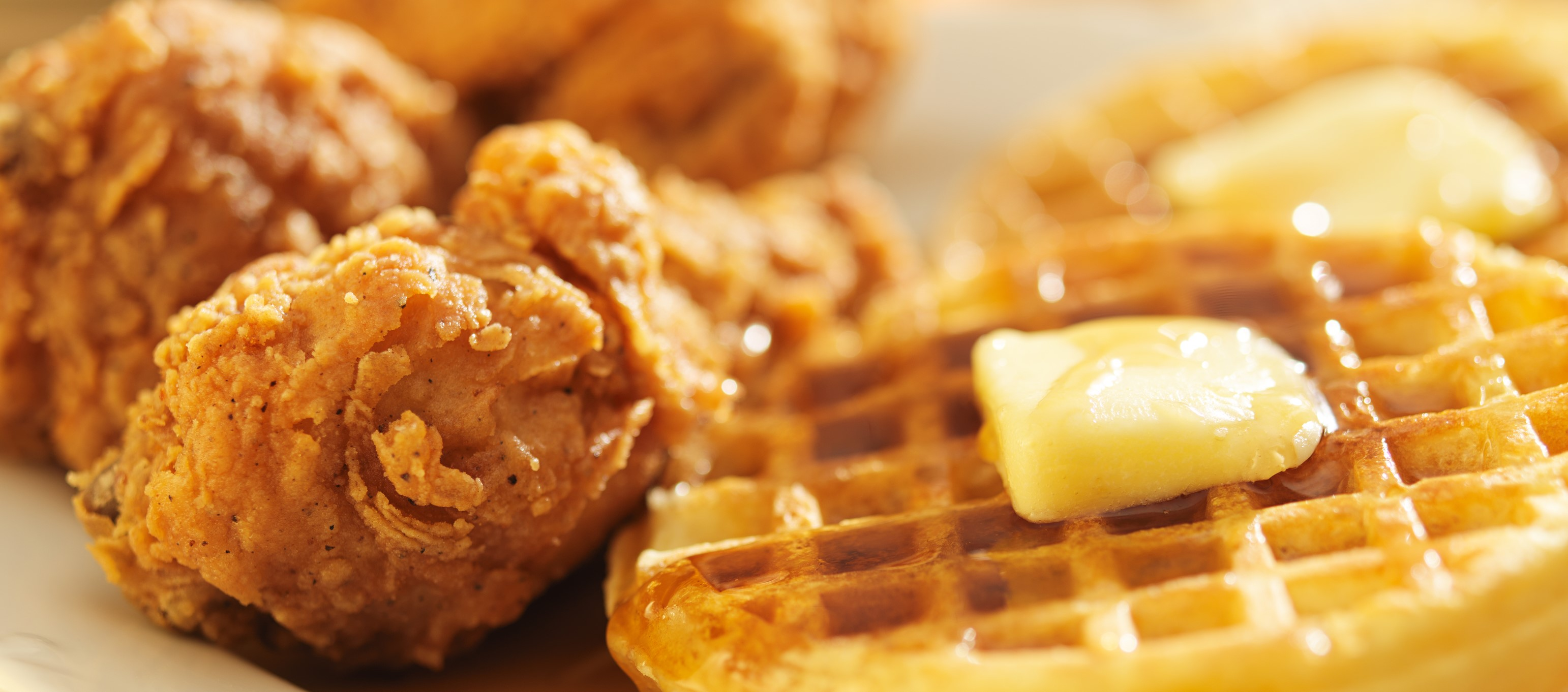 Detroit Aretha Franklin Motown Chicken & Waffles served tender crispy topped with Organic, 100% real pure Maple Syrup and Vegan Earth Balance margarine