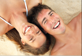 Couple lying in the sand
