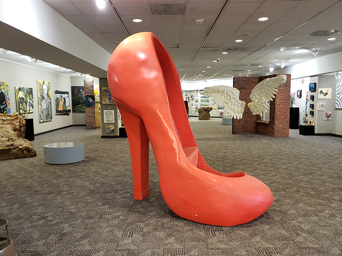 larger than life size red high heel shoe by Jerrel Sustaita