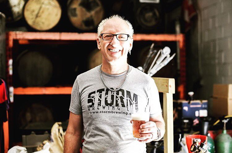 James from storm brewing holding a beer