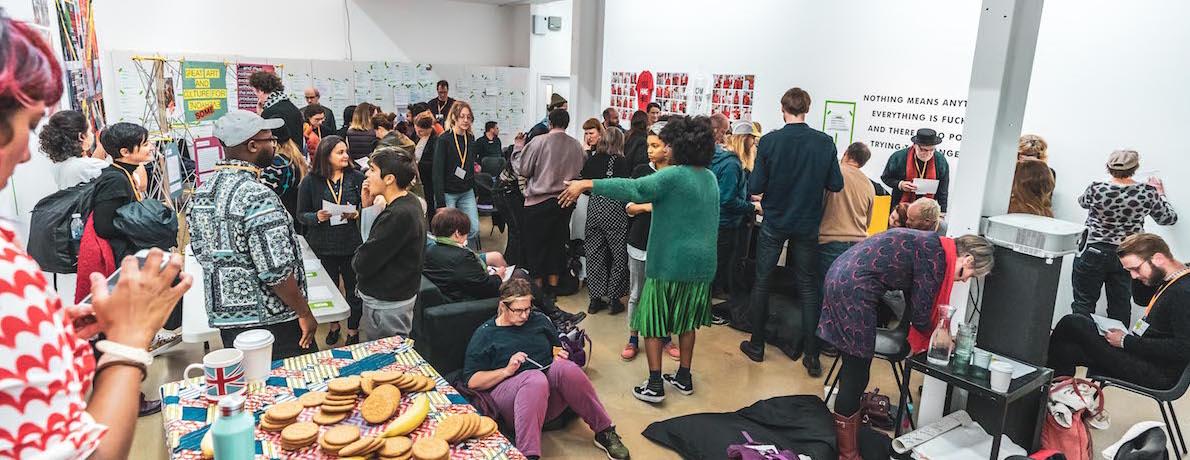 A wide shot of Elsa James's lab at the Social Art Summit
