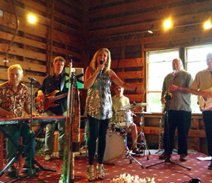 The Windmills perform in the Laudholm barn in 2014