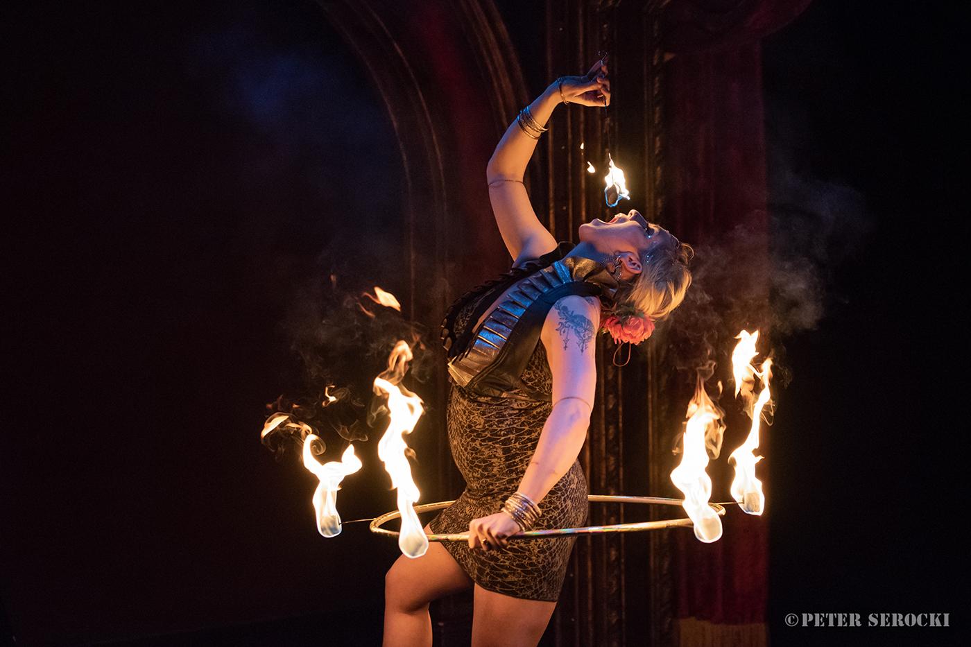 Raks Inferno performer eating fire in a fire hoop