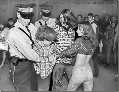 Cops taking away a hippie