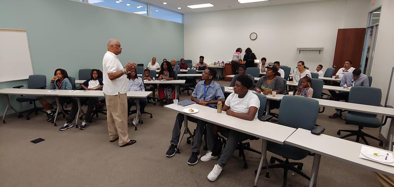 Fred Whitten instructing youth