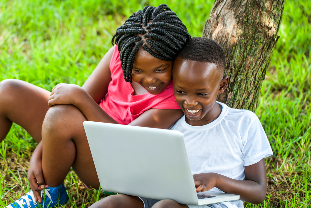 Boy and Girl on laptop