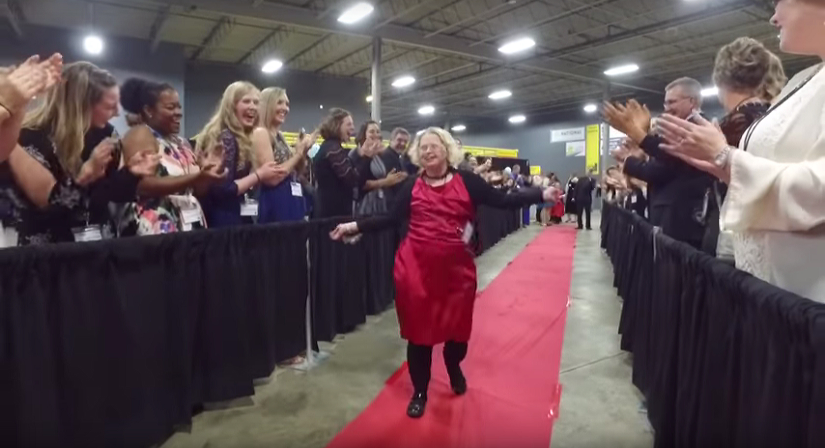 An honored guest walks the red carpet