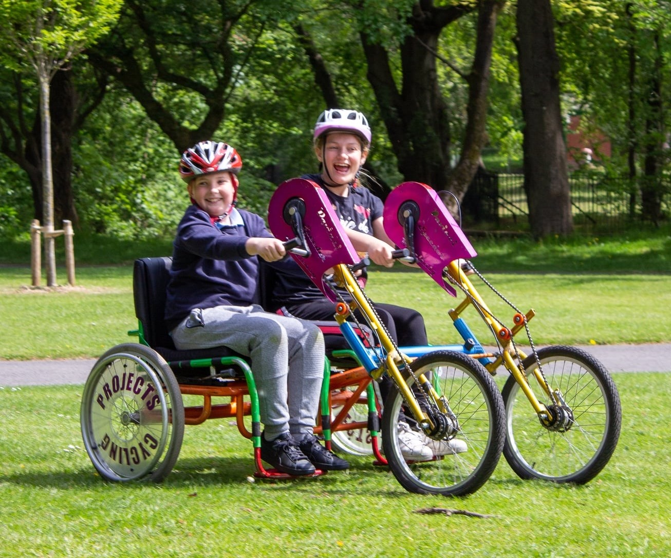 Two children on an adpated bike