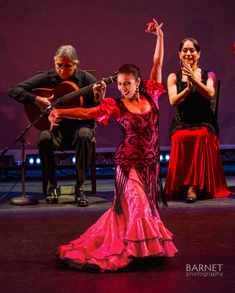 Angelita Dancing La Caña in vibrant pink and black lace