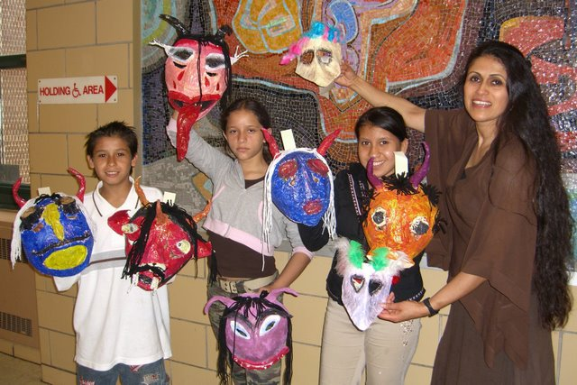 Lucrecia Novoa with children from one of her mask making workshop.