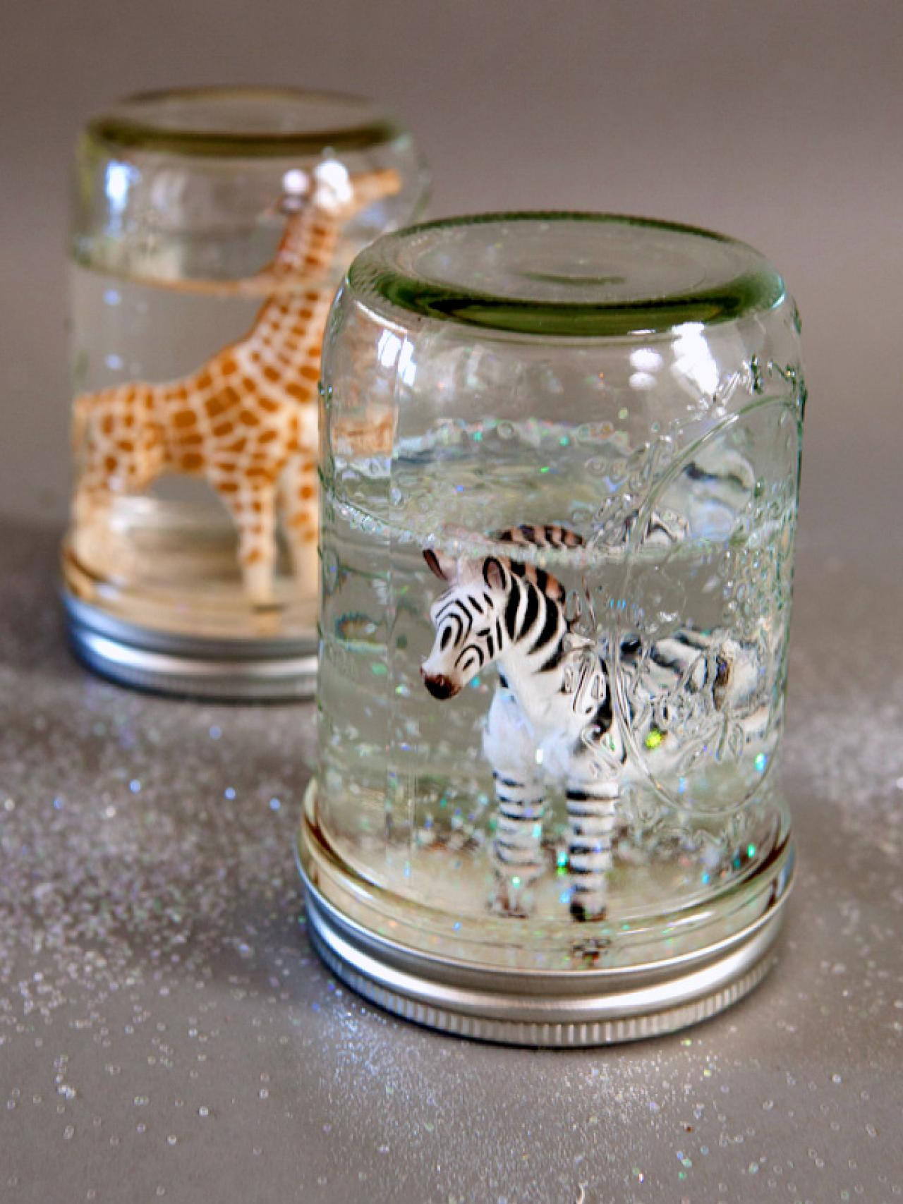photo of snow globes with animals inside
