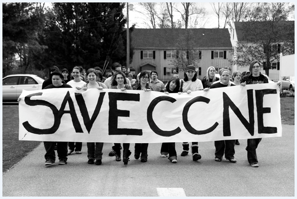 Students with Save Chester Banner