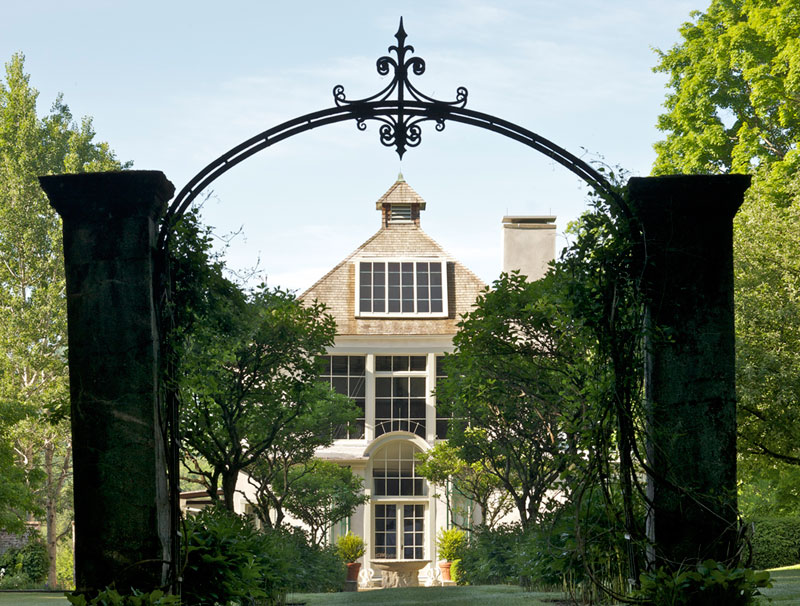 View of French's studio through archway at end of Hydrangea Path