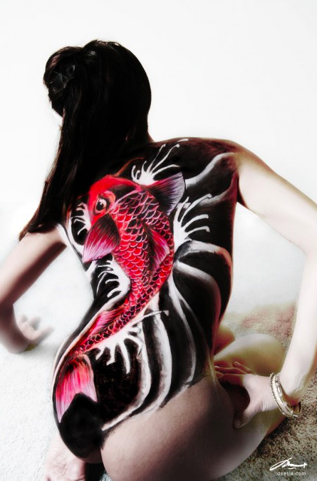 A koi fish body painting inspired by a Japanese tattoo, one of the most popular body painting designs.