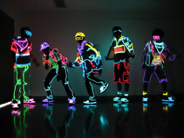 Dancers wearing glow outfits