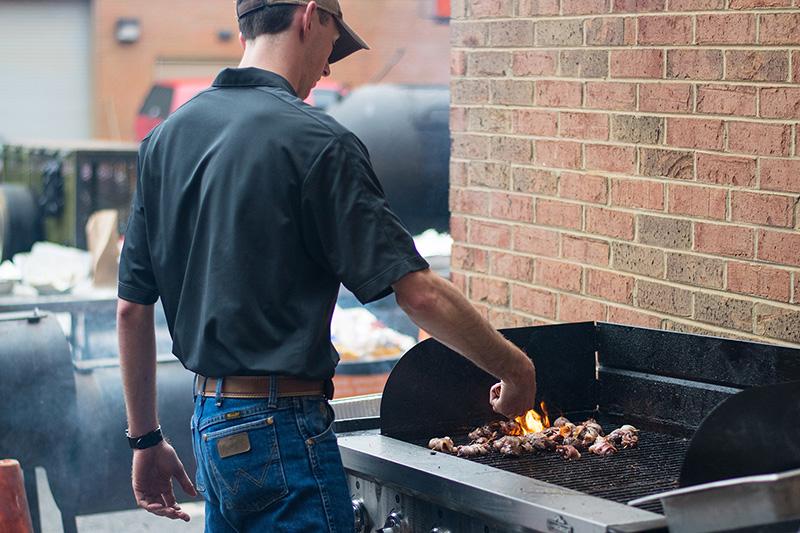 Student grilling venison burgers.