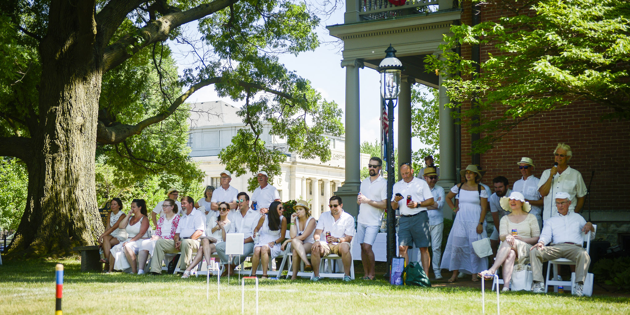 Photograph of people watching croquet