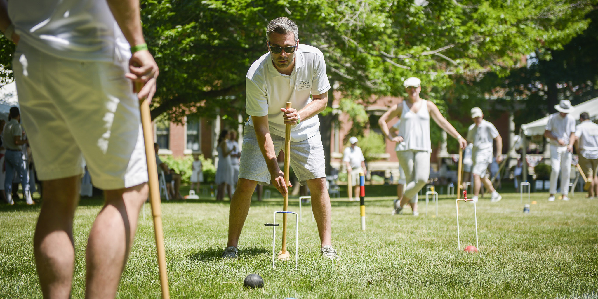photograph of people playing croquet