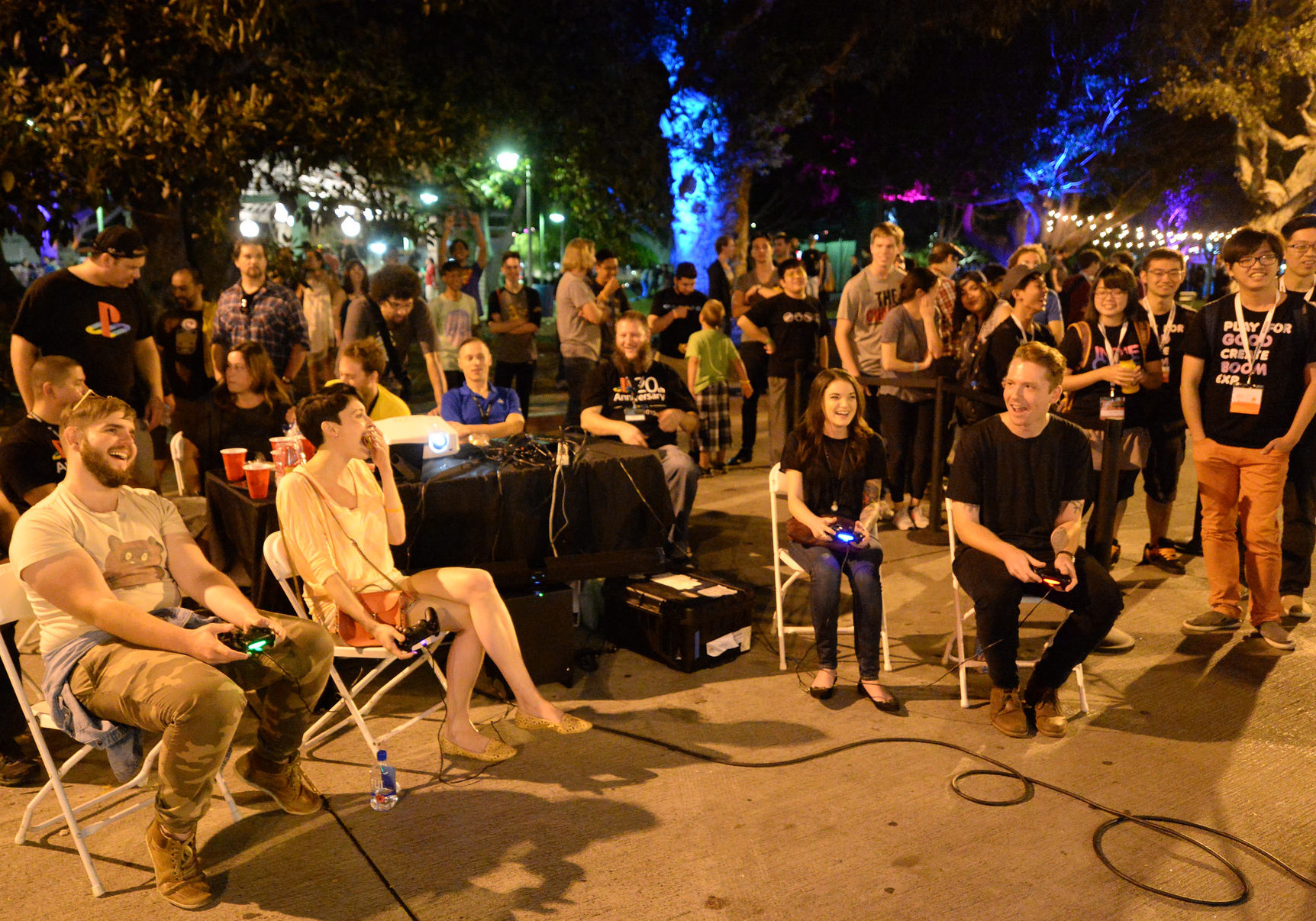 Attendees excitedly watch a competitive game at Night Games