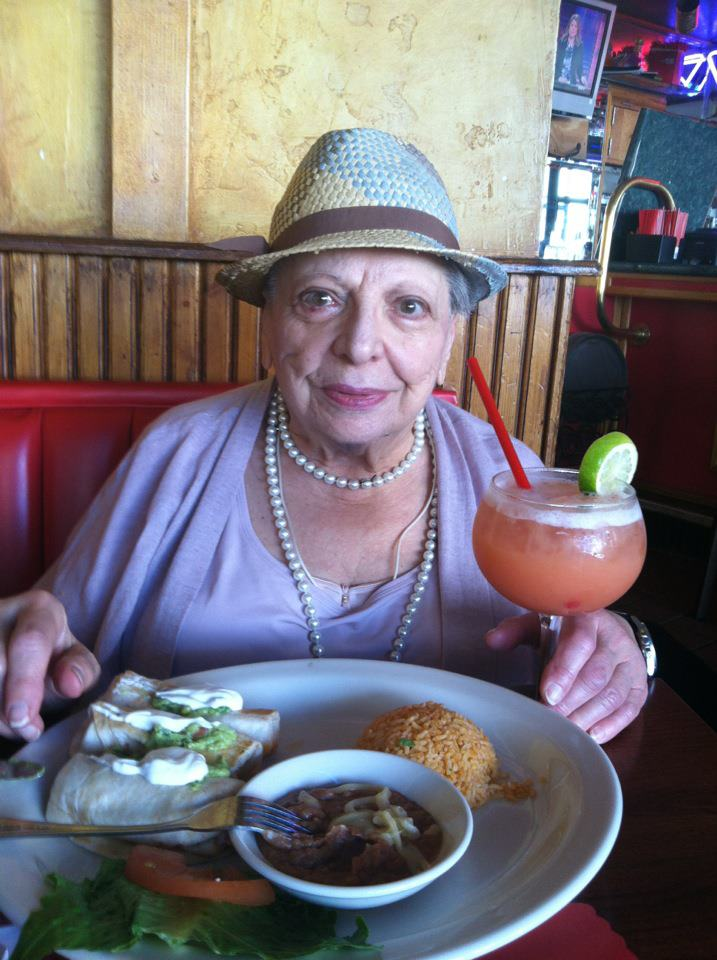 Elder enjoy a birthday lunch out with a drink