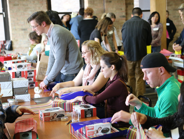 young professionals wrap gifts to make sure every elder is remembered on their birthday