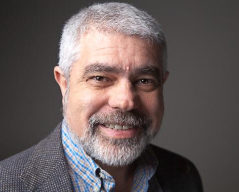 Dr. Vic Uzumeri